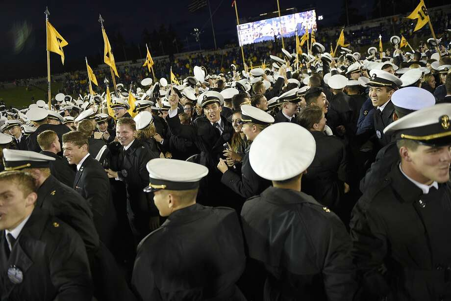 Navy midshipmen and fans storm the field and celebrate the 46-40 win over No. 6 Houston in Annapolis, Md. Photo: Nick Wass, Associated Press