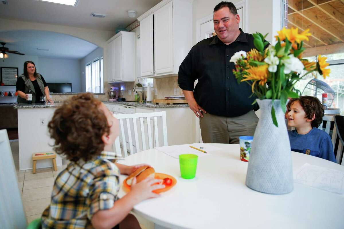 Murray Pawloski, who supports GOP nominee Donald Trump for president, jokes around with his sons, Drake, 3, and Dylan, 6, while making dinner Thursday in Katy. He originally backed Ted Cruz.