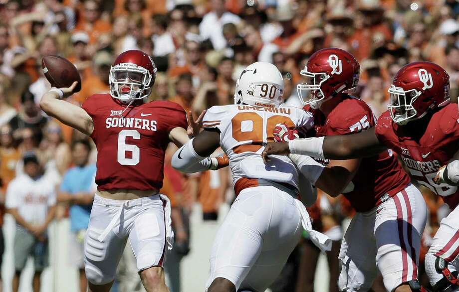 Oklahoma quarterback Baker Mayfield (6) throws a touchdown pass as offensive linemen Dru Samia (75) and Erick Wren (58) block Texas defensive end Charles Omenihu (90) during the second half of an NCAA college football game in Dallas, Saturday, Oct. 8, 2016. Oklahoma wide receiver Dede Westbrook caught the pass and Oklahoma won 45-40. (AP Photo/LM Otero) Photo: LM Otero, STF / Associated Press / Copyright 2016 The Associated Press. All rights reserved.