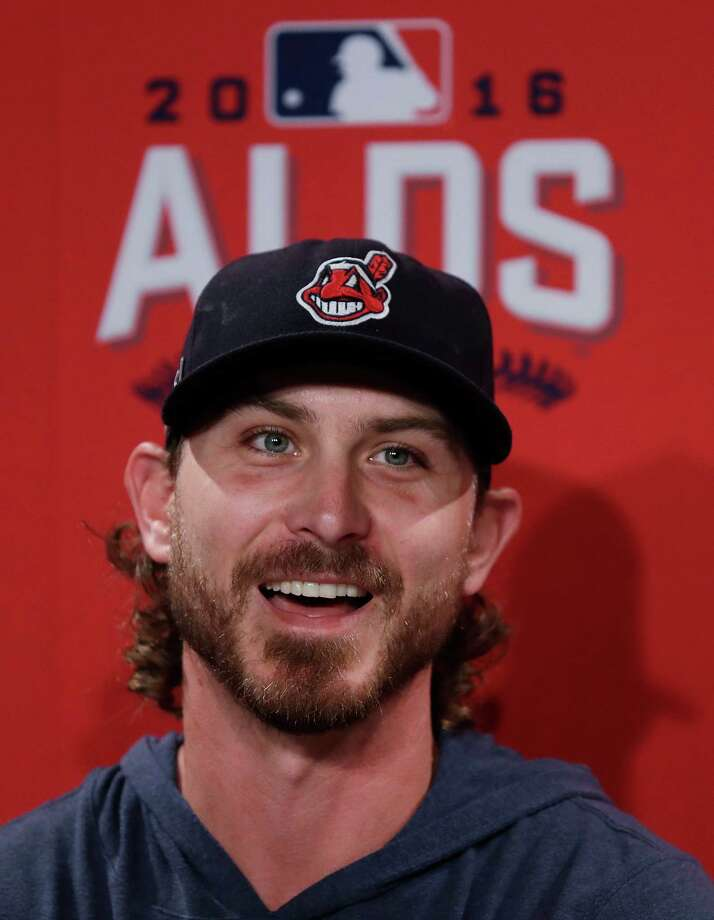 Cleveland Indians starting pitcher Josh Tomlin laughs as he's asked a question during a news conference after a team practice at Fenway Park in Boston, Saturday, Oct. 8, 2016. Tomlin is scheduled to face Boston Red Sox starter Clay Buchholz in Game 3 of a baseball American League Division Series. The Indians hold a 2-0 lead in the series. (AP Photo/Charles Krupa) Photo: Charles Krupa, STF / Copyright 2016 The Associated Press. All rights reserved.