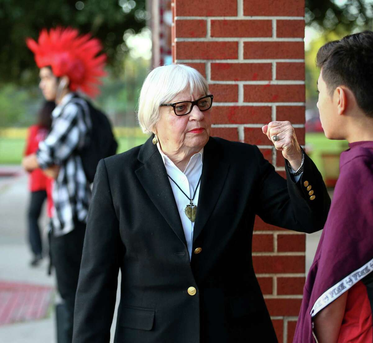 Bertie Simmons, the 82-year-old principal of Furr High School, jokes with Ivan Hernandez before classes begin. The HISD campus was plagued by gangs when she arrived in 2000.