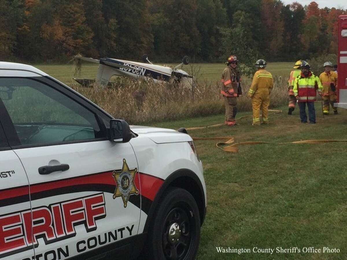Two men walked away with minor injuries from this plane crash after a 1958 Cessna Skyhawk 172 flipped over near the runway at Argyle Airport following a pilot re-certification flight Saturday afternoon. (Photo courtesy of Washington County Sheriff)