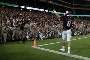 Texas A&M Aggies quarterback Trevor Knight (8) celebrates his touchdown with the fans in the end zone during the second overtime of a college football game at Kyle Field, Saturday, Oct. 8, 2016 in College Station.