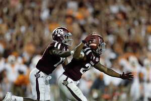 Texas A&M Aggies defensive back Armani Watts (23) celebrates his interception to win with Alex Sezer (17) during double overtime during a college football game at Kyle Field, Saturday, Oct. 8, 2016 in College Station.