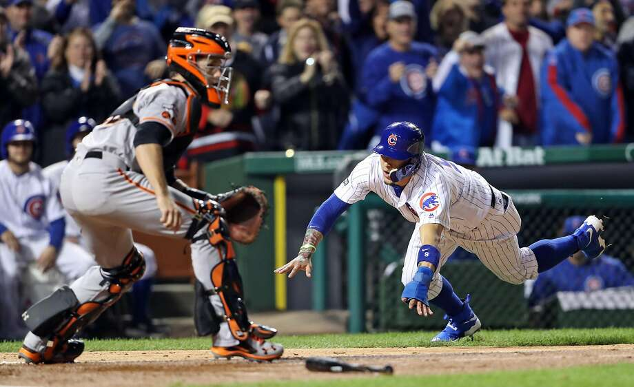 San Francisco Giants' Buster Posey awaits the throw as Chicago Cubs' Javier Baez scores on Kyle Hendricks' 2-run single in 2nd inning during Game 2 of the National League Division Series at Wrigley Field in Chicago. IL, on Saturday, October 8, 2016. Photo: Scott Strazzante, The Chronicle