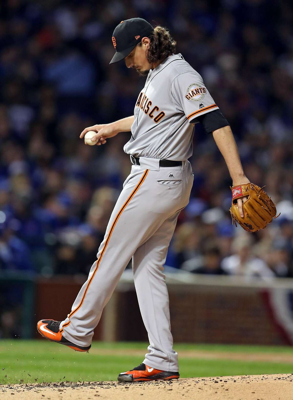 San Francisco Giants' Jeff Samardzija reacts during Chicago Cubs' 3-run 2nd inning during Game 2 of the National League Division Series at Wrigley Field in Chicago. IL, on Saturday, October 8, 2016.