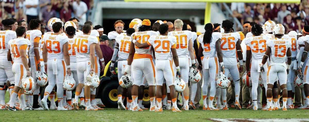 Tennessee Volunteers defensive back Evan Berry (29) hugs Kendal Vickers (39) as defensive lineman Danny O'Brien (95) was loaded onto a stretcher after suffering an injury during the fourth quarter of a college football game at Kyle Field, Saturday, Oct. 8, 2016 in College Station.
