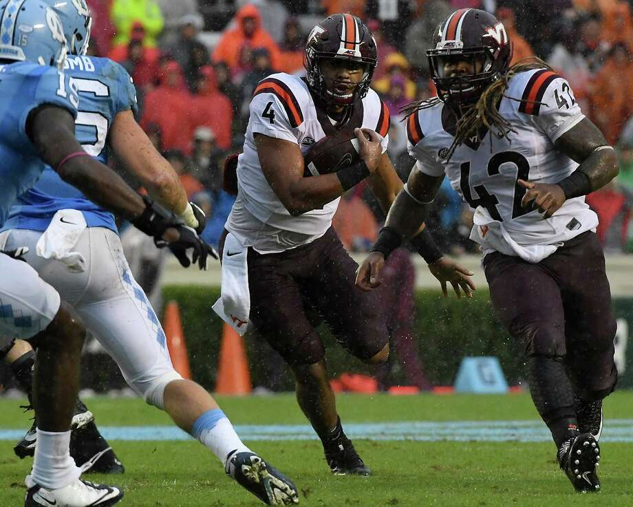 Virginia Tech quarterback Jerod Evans, center, accounted for three TDs to lead the Hokies past North Carolina. Photo: Mike Comer, Stringer / 2016 Getty Images