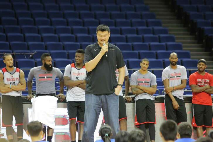 Retired Chinese basketball superstar Yao Ming, tallest, and players of Houston Rockets take part in a basketball camp event in Shanghai, China, 8 October 2016.
