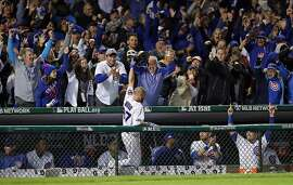 Chicago Cubs' fans cheer as Travis Wood makes a curtain call after his 4th inning home run against San Francisco Giants' George Kontos during Game 2 of the National League Division Series at Wrigley Field in Chicago. IL, on Saturday, October 8, 2016.