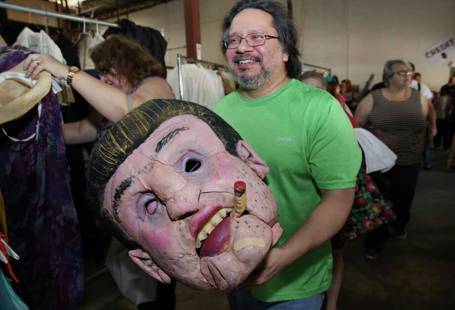 Joe Franco bought a giant head at Houston Grand Opera's costume and prop sale on Saturday. Franco said he had no idea what the prop was used for, but that it didn't matter. Other buyers at the rummage sale found shoes for 50 cents and wedding dresses for $50.  Photo: Yi-Chin Lee, Staff / © 2016  Houston Chronicle