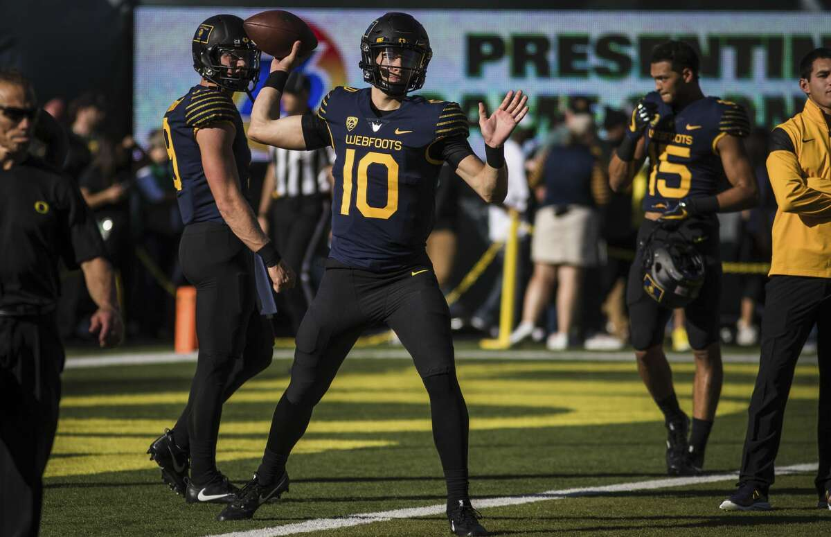 Oregon quarterback Justin Herbert (10), warms up before playing Washington in an NCAA college football game Saturday, Oct. 8, 2016, in Eugene, Ore. (AP Photo/Thomas Boyd)