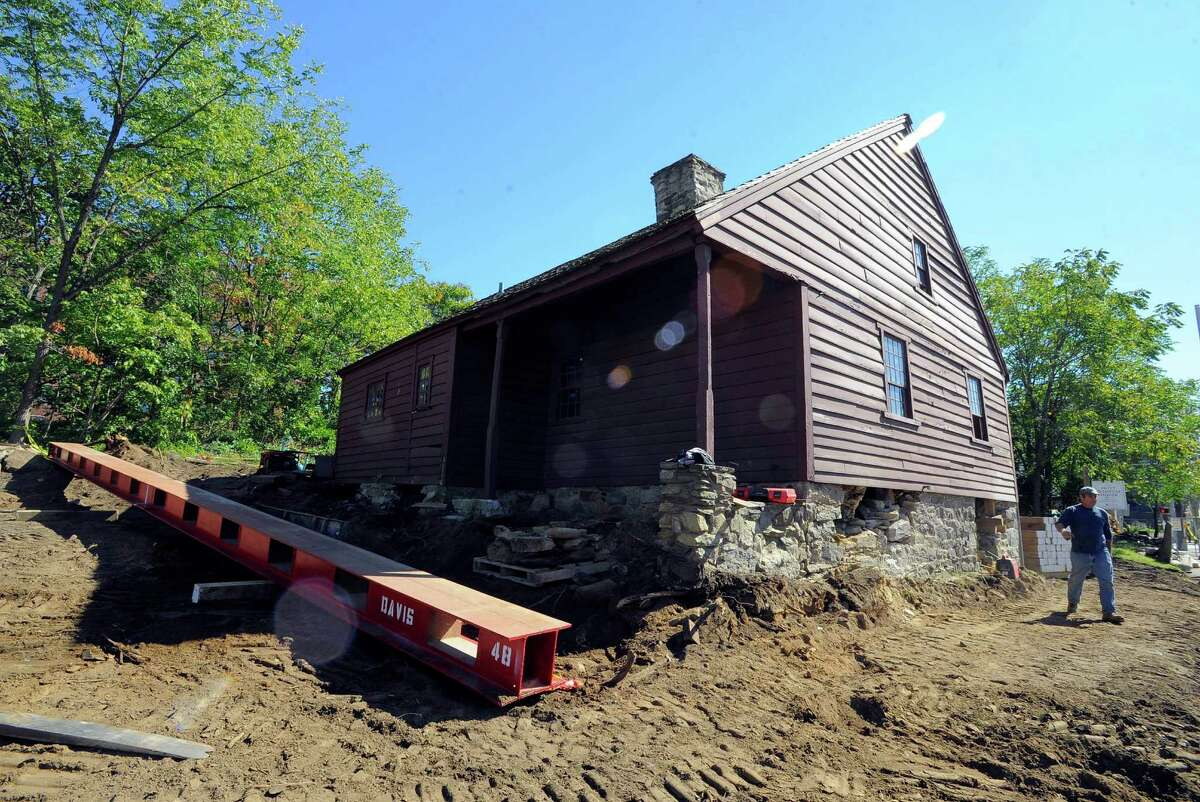 Ongoing work continues on Friday, Oct. 7, 2016, on the Hoyt Bedford house on Bedford Street in Stamford, Conn. as a contractor readies the structure for its move to the Historic Society's headquarters on High Ridge Road.