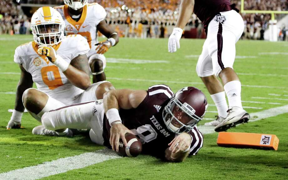 Texas A&M quarterback Trevor Knight (8) rushes for a touchdown as Tennessee defensive end Derek Barnett (9) defends during overtime in an NCAA college football game Saturday, Oct. 8, 2016, in College Station, Texas. Texas A&M won 45-38 in overtime. (AP Photo/David J. Phillip) Photo: David J. Phillip, STF / Associated Press / AP