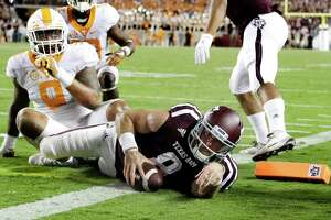 Texas A&M quarterback Trevor Knight (8) rushes for a touchdown as Tennessee defensive end Derek Barnett (9) defends during overtime in an NCAA college football game Saturday, Oct. 8, 2016, in College Station, Texas. Texas A&M won 45-38 in overtime. (AP Photo/David J. Phillip)