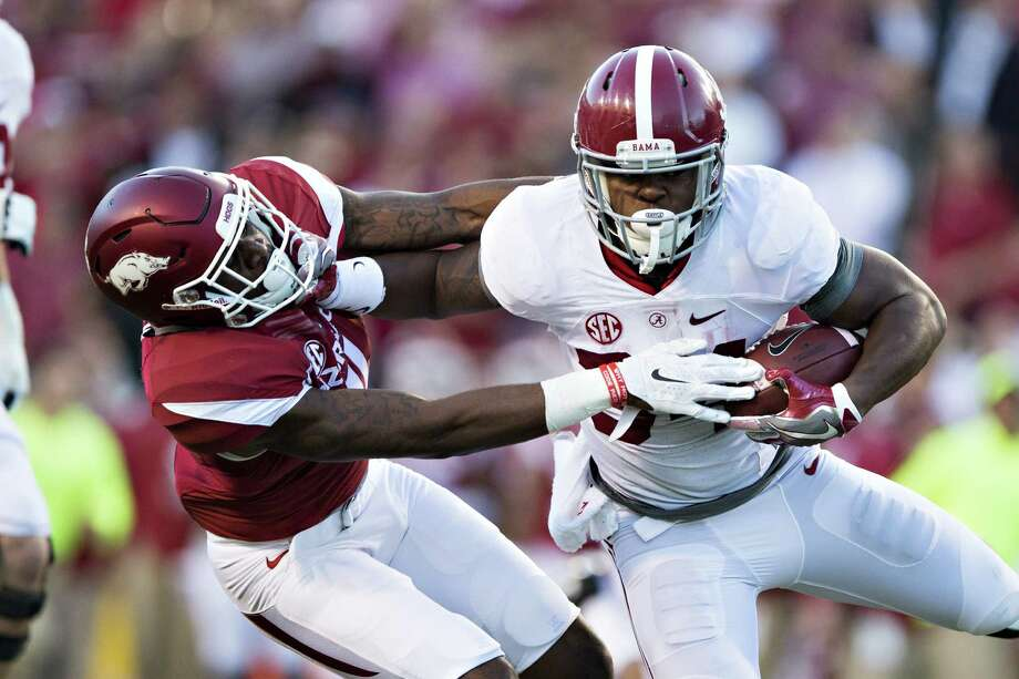 FAYETTEVILLE, AR - OCTOBER 8:  Damian Harris #34 of the Alabama Crimson Tide runs for a touchdown and stiff arms Ryan Pulley #11 of the Arkansas Razorbacks at Razorback Stadium on October 8, 2016 in Fayetteville, Arkansas.  (Photo by Wesley Hitt/Getty Images) Photo: Wesley Hitt, Stringer / 2016 Getty Images