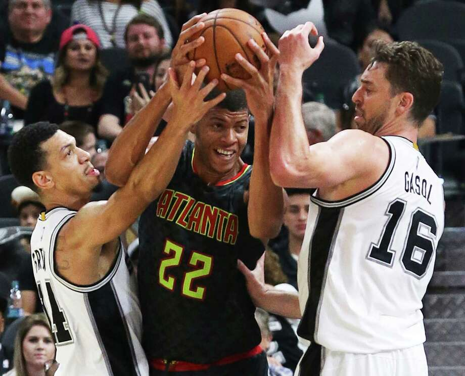 Danny Green and Pau Gasol make it tough for Walter Tavares under the hoop  as the Spurs host the Hawks in the home opener for the preseason on October 8, 2016. Photo: TOM REEL, STAFF / SAN ANTONIO EXPRESS-NEWS / 2016 SAN ANTONIO EXPRESS-NEWS
