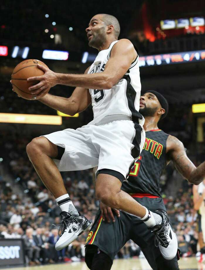 Tony Parker beats Malcolm Delaney to the hoop for a second half basket  as the Spurs host the Hawks in the home opener for the preseason on October 8, 2016. Photo: TOM REEL, STAFF / SAN ANTONIO EXPRESS-NEWS / 2016 SAN ANTONIO EXPRESS-NEWS
