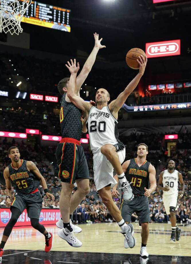Manu Ginobili floats a hook in over Ryan Kelly as the Spurs host the Hawks in the home opener for the preseason on October 8, 2016. Photo: TOM REEL, STAFF / SAN ANTONIO EXPRESS-NEWS / 2016 SAN ANTONIO EXPRESS-NEWS