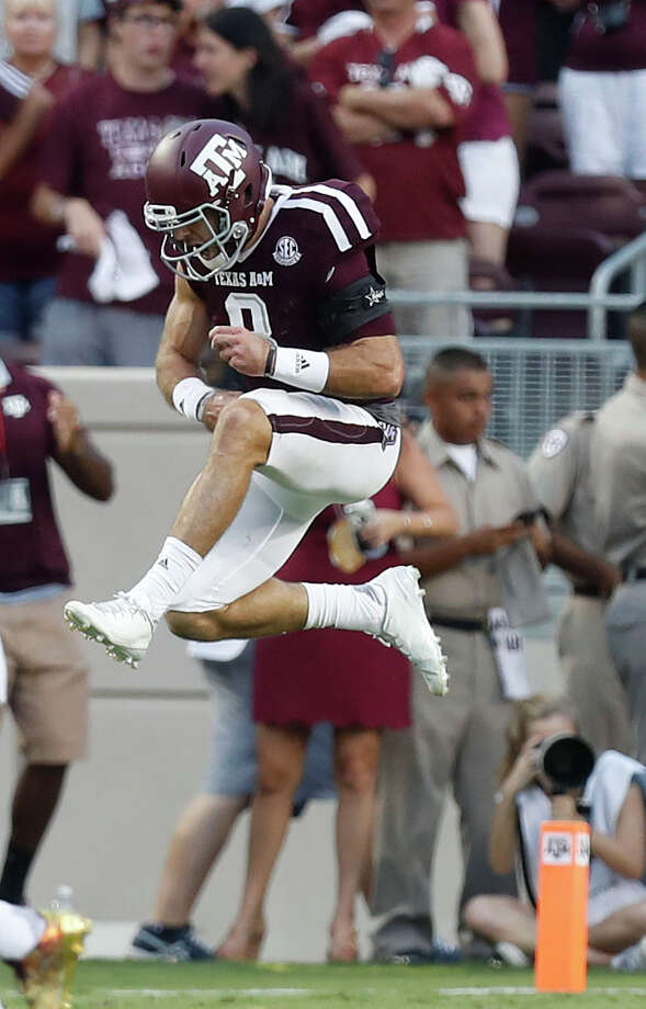 Texas A&M quarterback Trevor Knight celebrates after he raced 62 yards for a touchdown during the fourth quarter against Tennessee on Saturday at Kyle Field. Knight also had TD runs in the first quarter and the second overtime. Photo: Karen Warren, Staff Photographer / 2016 Houston Chronicle