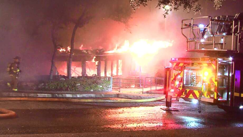 A two-alarm fire erupted at about 1:30 a.m. Saturday, Oct. 8, 2016, at a building that was previously occupied by the Alamo Women's Clinic in the 8600 block of Wurzbach Road. A total damage estimate is being assessed. Photo: Pro 21 Video