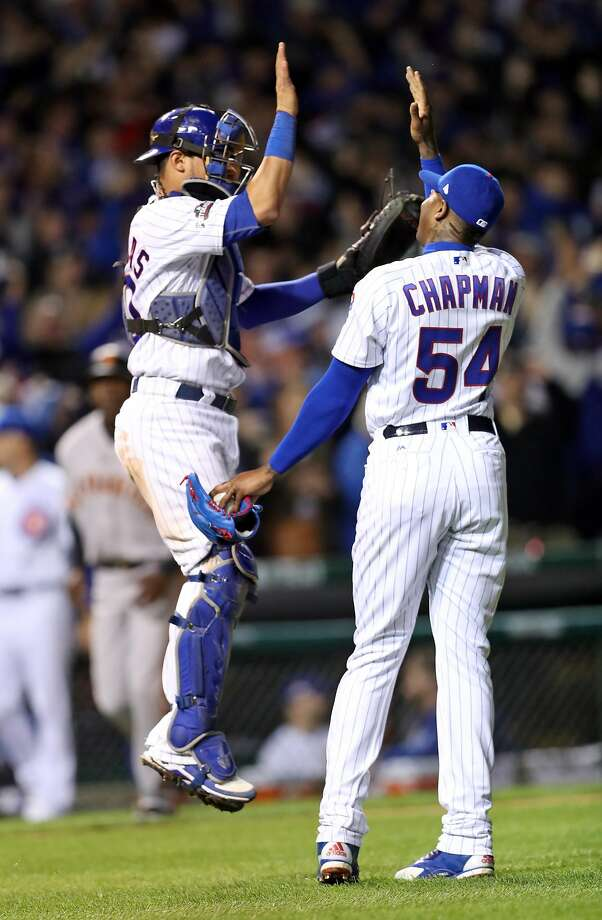 Chicago Cubs' Willson Contreras and Aroldis Chapman celebrate Cubs' 5-2 win over San Francisco Giants in Game 2 of the National League Division Series at Wrigley Field in Chicago. IL, on Saturday, October 8, 2016. Photo: Scott Strazzante, The Chronicle