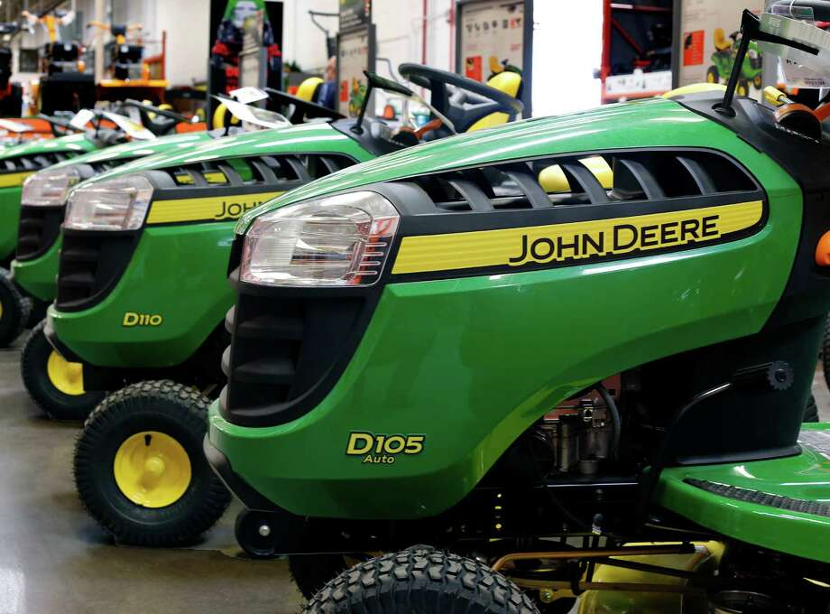 Deere lawn tractors are on display at a Home Depot in Robinson Township, Pa. Financing at Deere & Co., which leases much of its farm and construction equipment, has risen in recent years. Companies see the loans as a useful, safe way to drum up business. But short sellers warn that defaults are coming. Photo: Associated Press /File Photo / Copyright 2016 The Associated Press. All rights reserved. This material may not be published, broadcast, rewritten or redistribu