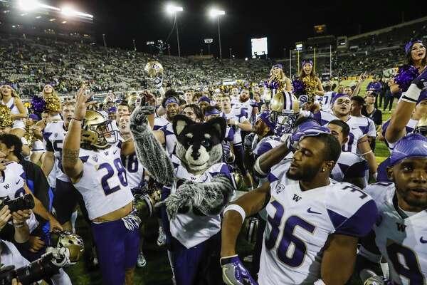 Washington celebrates their win over Oregon in an NCAA college football game Saturday, Oct. 8, 2016, in Eugene, Ore.  Washington beat Oregon 70-21. (AP Photo/Thomas Boyd)