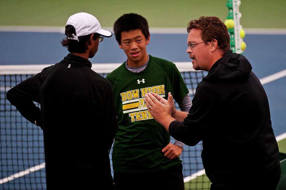ERIN KIRKLAND | ekirkland@mdn.net Dow High varsity tennis coach Terry Schwartzkopf, right, talks to his players Daniel Zhang, center, and Gopal Parthasarathy, left, during the Saginaw Valley League tennis championship  in late September at the Greater Midland Tennis Center. Under his leadership, the Dow program has won five state titles over the past seven seasons.