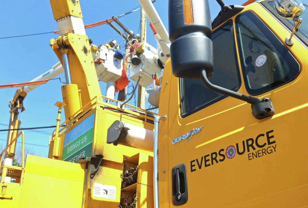 Eversource work crews on the scene at the corner of Hales Road and and Greens Farm Road in Westport on Friday, April 15, 2016. (File photo)