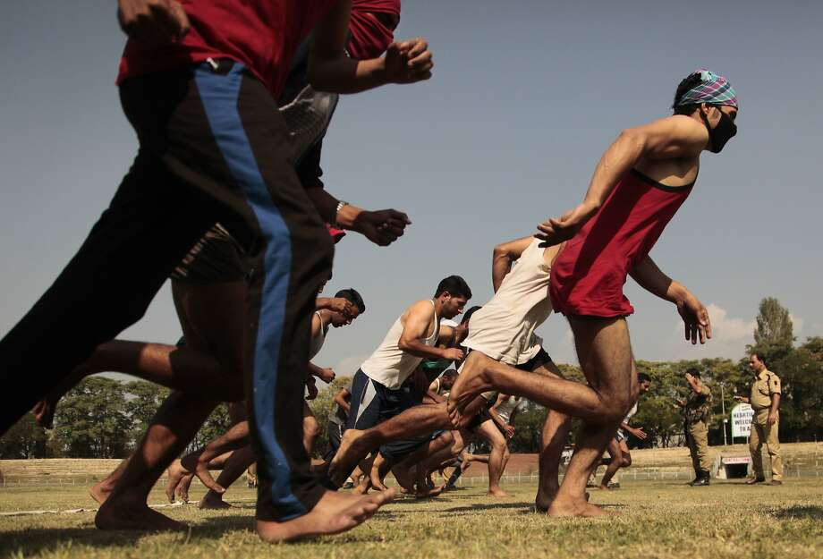 Kashmiris take part in a physical fitness test during a police recruitment drive last month in Srinagar, the largest city in the Indian-controlled region. Photo: Mukhtar Khan, Associated Press