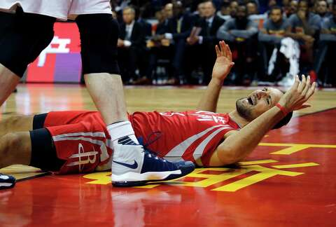 9ca4bff0c1f Houston Rockets Ryan Anderson reacts after he falls to the court during  their preseason NBA game