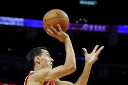 Houston Rockets Pablo Prigioni, left, shoots for a basket as New Orleans Pelicans Dante Cunningham watches during their preseason NBA game in Shanghai, China, Sunday, October, 9, 2016. (AP Photo)