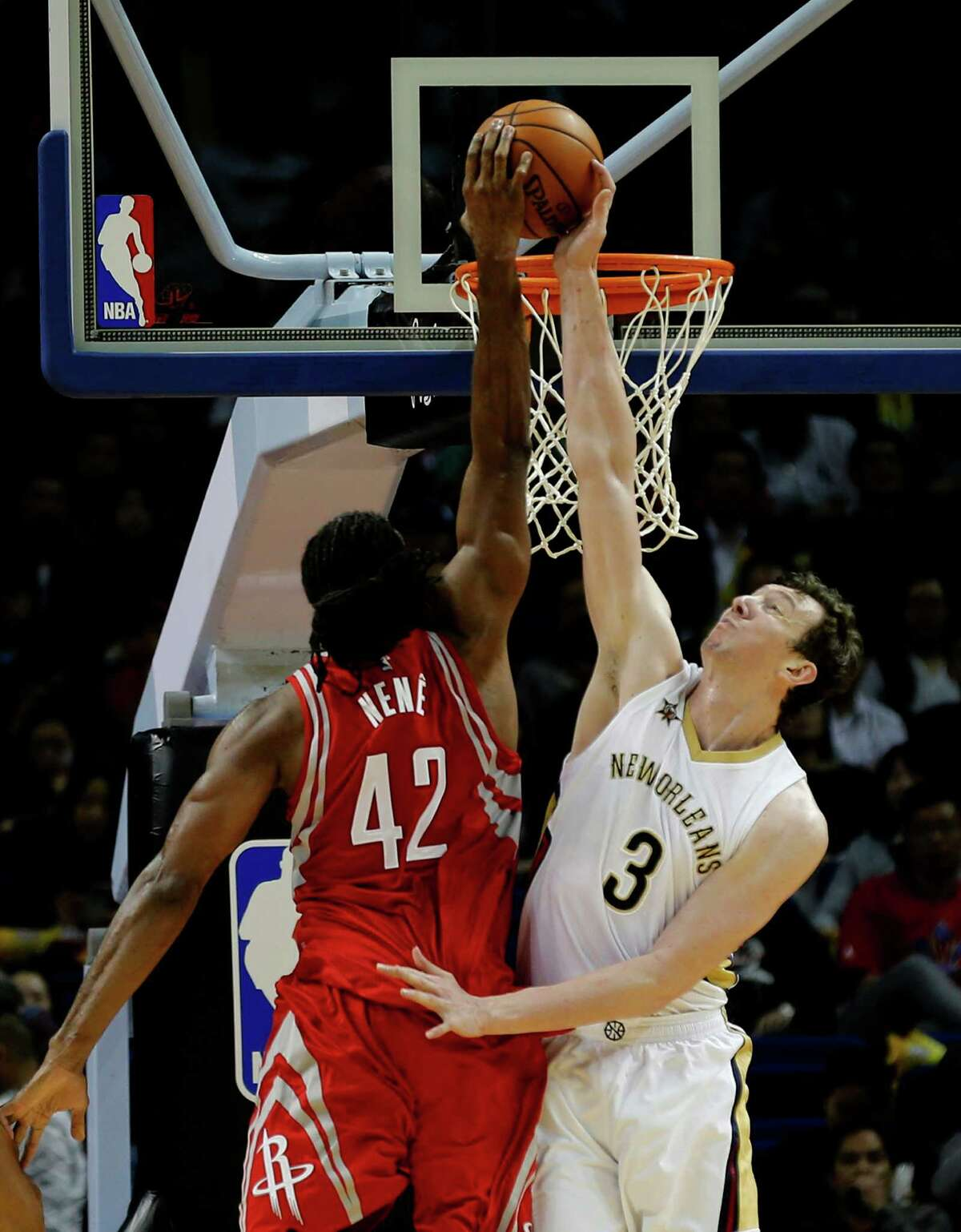 Houston Rockets Nene Hilario, left, has his shot blocked by New Orleans Pelicans Omer Asik during their preseason NBA game in Shanghai, China, Sunday, October, 9, 2016. (AP Photo)