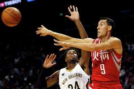 Houston Rockets Pablo Prigioni, right, passes the ball as New Orleans Pelicans Buddy Hield attempts to block during their preseason NBA game in Shanghai, China, Sunday, October, 9, 2016. (AP Photo)