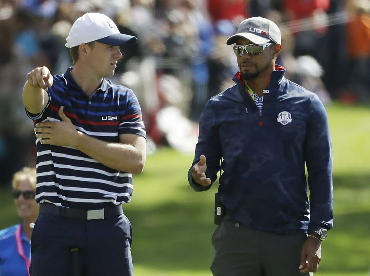 United States vice-captain Tiger Woods talks to United States?' Jordan Spieth on the 16th hole during a practice round for the Ryder Cup golf tournament Thursday, Sept. 29, 2016, at Hazeltine National Golf Club in Chaska, Minn.