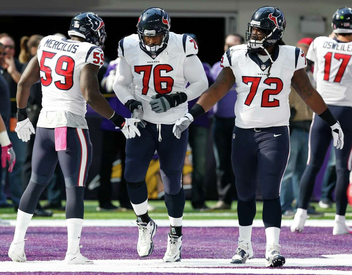 Houston Texans outside linebacker Whitney Mercilus (59) greets Houston Texans tackle Duane Brown (76) as he he runs onto the field before an NFL football game at U.S. Bank Stadium on Sunday, Oct. 9, 2016, in {city. Brown will suit up for the first time since suffering an injury last season.