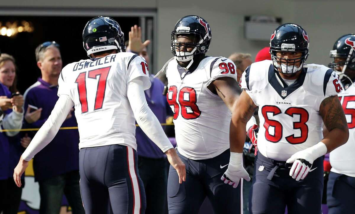 Houston Texans quarterback Brock Osweiler (17) greets his teammates as they run onto the field before an NFL football game at U.S. Bank Stadium on Sunday, Oct. 9, 2016, in {city.
