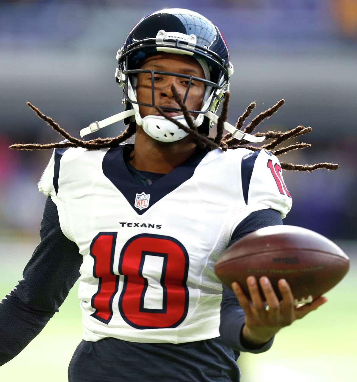 Houston Texans wide receiver DeAndre Hopkins (10) catches a football while warming up before an NFL football game against the Minnesota Vikings at U.S. Bank Stadium on Sunday, Oct. 9, 2016, in {city.