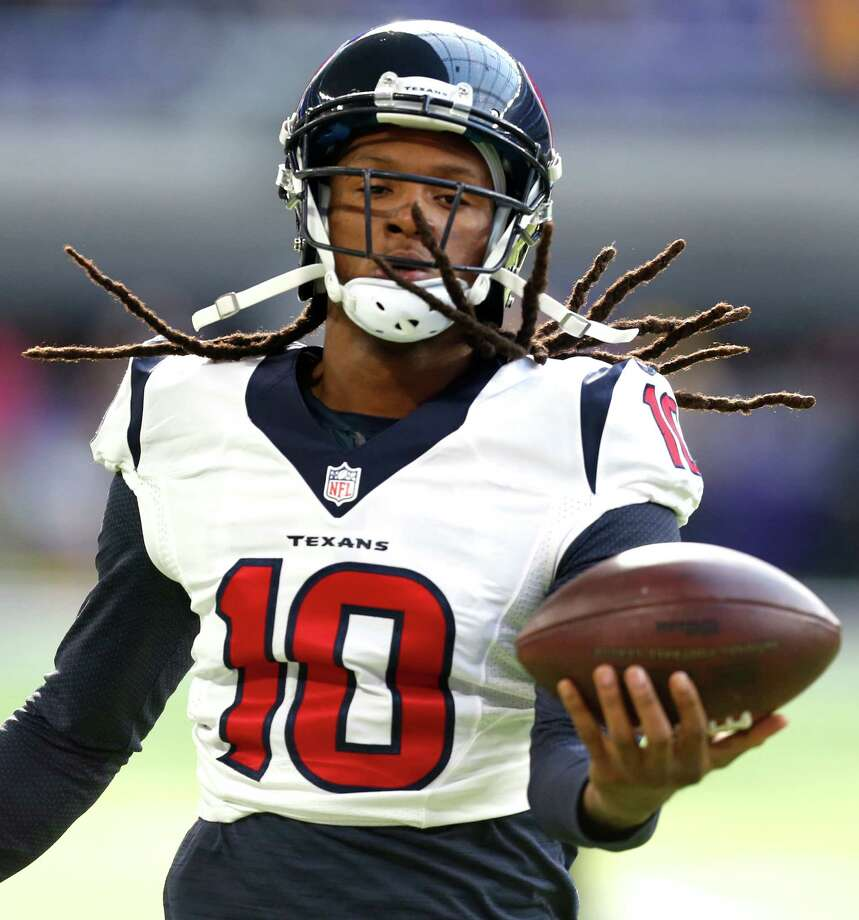 Houston Texans wide receiver DeAndre Hopkins (10) catches a football while warming up before an NFL football game against the Minnesota Vikings at U.S. Bank Stadium on Sunday, Oct. 9, 2016, in {city. Photo: Brett Coomer, Houston Chronicle / © 2016 Houston Chronicle