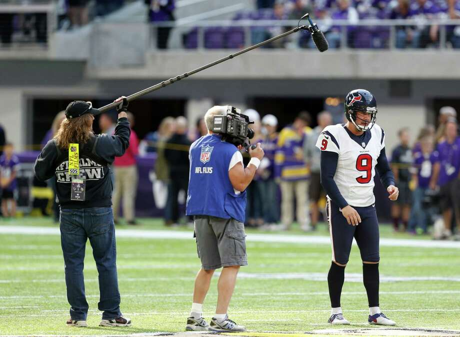 Houston Texans punter Shane Lechler (9) is followed by an NFL Films crew while warming up before an NFL football game against the Minnesota Vikings at U.S. Bank Stadium on Sunday, Oct. 9, 2016, in {city. Photo: Brett Coomer, Houston Chronicle / © 2016 Houston Chronicle