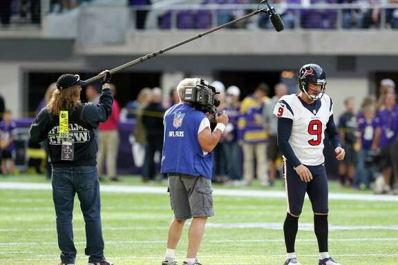 Houston Texans punter Shane Lechler (9) is followed by an NFL Films crew while warming up before an NFL football game against the Minnesota Vikings at U.S. Bank Stadium on Sunday, Oct. 9, 2016, in {city.