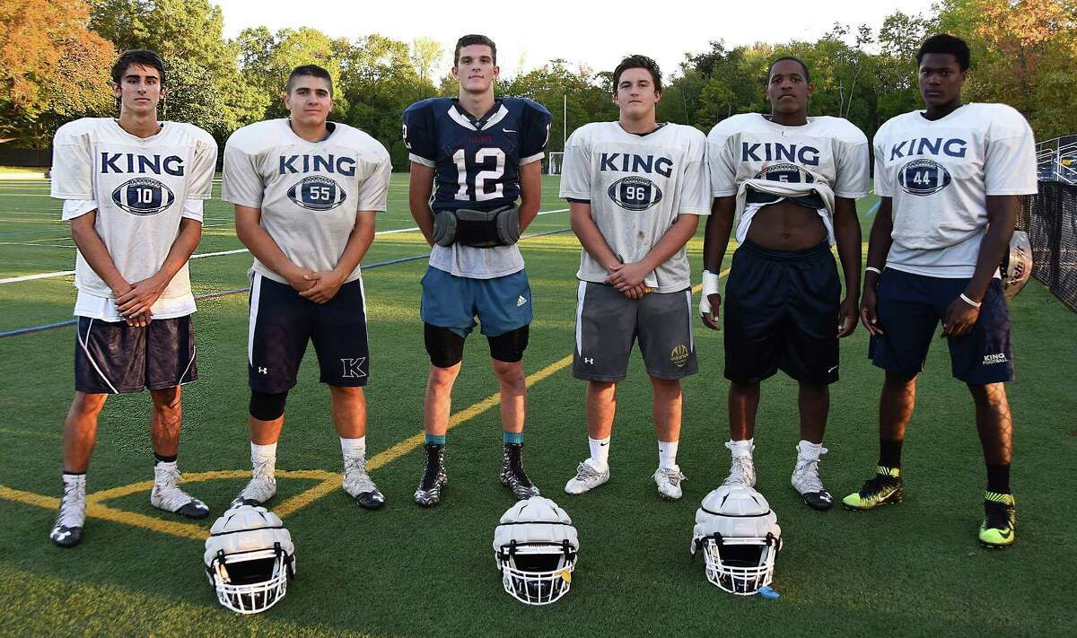 The King Low Heywood Thomas football team boasts seven residents of Norwalk in its starting line-up, including from left, Trey Canevari, Alex Canevari, Renn Lints, Kelly Gouin, Evan Henry and Levaughn Lewis. A seventh player, AJ Greene, wasn't at practice when the photo was taken.