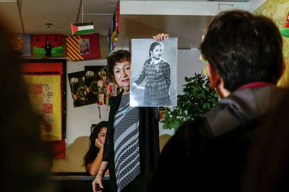 Gabriella Karin, who spent part of World War II in hiding from the Nazis, speaks to students at Animo Ralph Bunche High School in California about her experiences. Photo: Irfan Khan /TNS / Los Angeles Times
