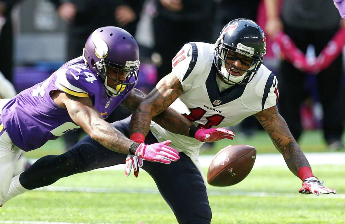 Minnesota Vikings cornerback Captain Munnerlyn (24) breaks up a pass intended for Houston Texans wide receiver Jaelen Strong (11) during the second quarter of an NFL football game at U.S. Bank Stadium on Sunday, Oct. 9, 2016, in {city.