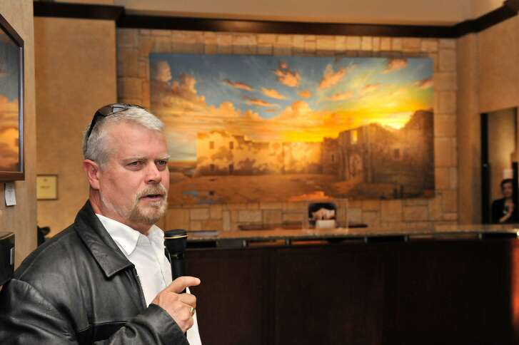 """Artist Mark Lemon discusses his painting, """"The Dawn of Texas,"""" after it is unveiled at the Emily Morgan Hotel in March 2012. The work is now for sale after the hotel declined to buy it for $60,000, including copyright privileges."""