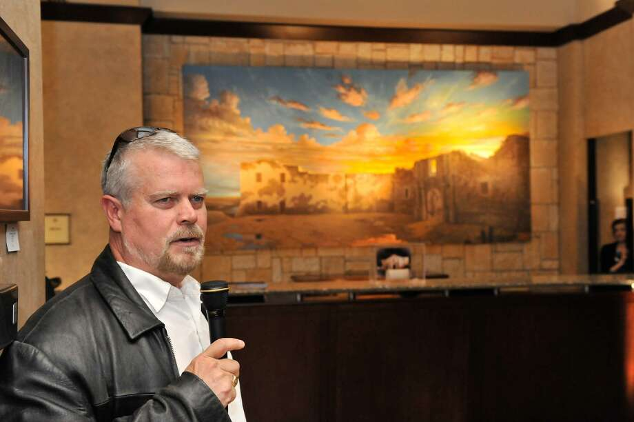 Artist Mark Lemon discusses his large painting of the Alamo after it was unveiled at the Emily Morgan Hotel in March 2012. Known for his attention to historical accuracy, Lemon painted the Alamo without a roof. Photo: Express-News File Photo / SAN ANTONIO EXPRESS-NEWS