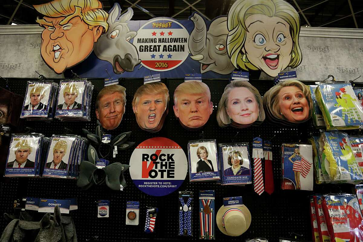 Presidential election costumes for sale at Spirit Halloween store Oct. 7, 2016, in Houston.