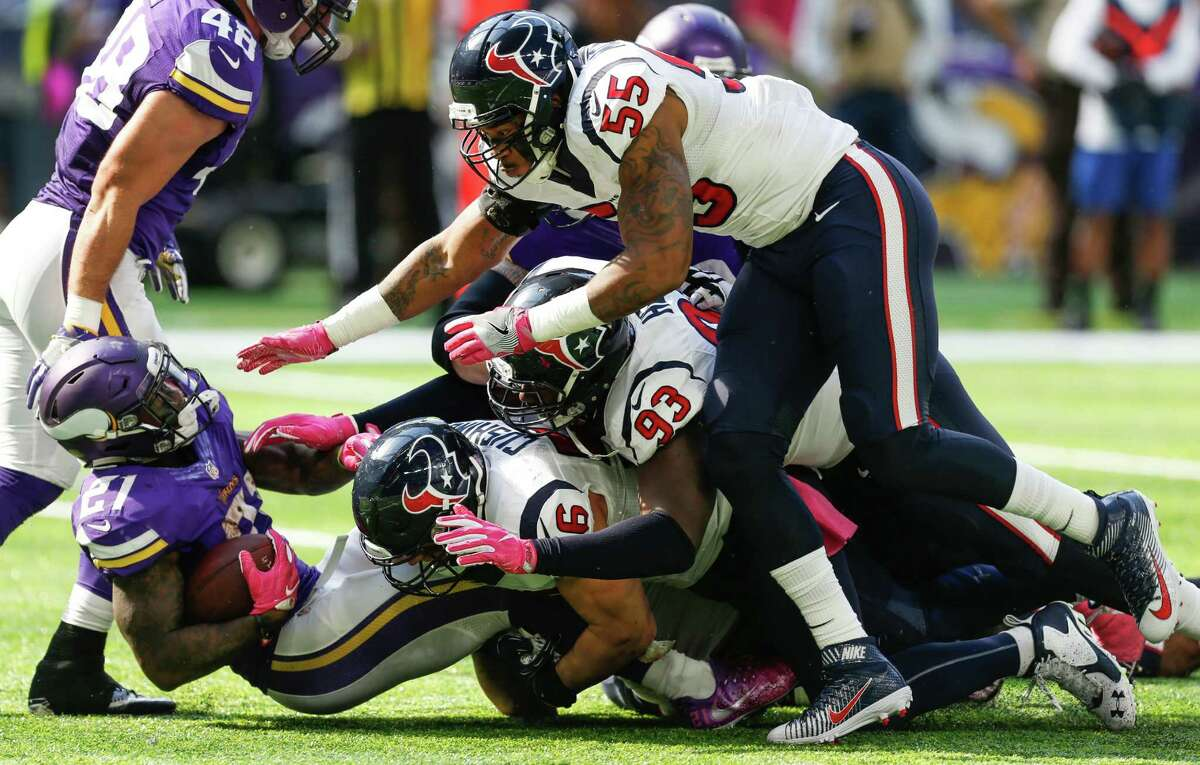 Minnesota Vikings running back Jerick McKinnon (21) is tackled by Houston Texans inside linebacker Brian Cushing (56), defensive tackle Joel Heath (93) and nside linebacker Benardrick McKinney (55) during the first quarter of an NFL football game at U.S. Bank Stadium on Sunday, Oct. 9, 2016, in Minneapolis.