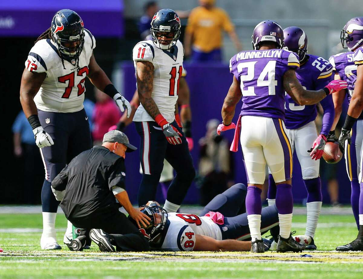 Houston Texans tight end Ryan Griffin (84) lies on the field after tackling Minnesota Vikings strong safety Andrew Sendejo on an interception return during the third quarter of an NFL football game at U.S. Bank Stadium on Sunday, Oct. 9, 2016, in Minneapolis.